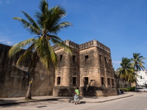 STONE TOWN, ZANZIBAR - MAY 02, 2015: Horizontal photo of the Old Fort (Ngome Kongwe) also known as the Arab Fort and the House of Wonders in Stone Town on Zanzibar island, Tanzania, East Africa