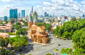 Ho Chi Minh City, Vietnam - July 17th, 2015: The beauty of Notre Dame cathedral architecture buildings over a hundred years old, so far is the high rise buildings for the Economic Development in Ho Chi Minh City, Vietnam