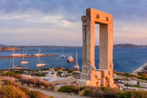 "Naxos island, Greece - JUNE 3: the Ancient marble gate ""Portara"" - the entrance to the temple of Apollo in JUNE 3, 2015, Naxos island, Cyclades, Greece."