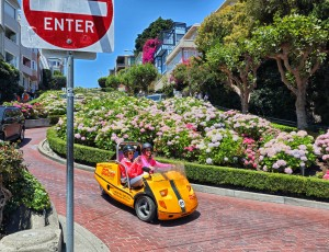 San Francisco, CA, USA - June 23rd, 2015: Tourists in a GoCar driving down San Francisco's famous winding Lombard Street.